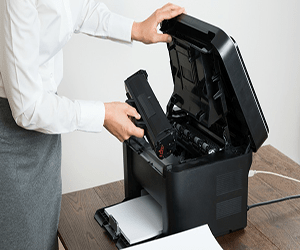 how to remove jammed paper from hp printer